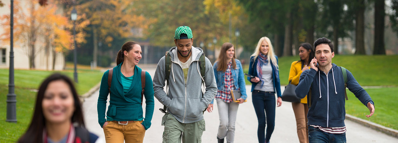 Group of college kids walking on campus.