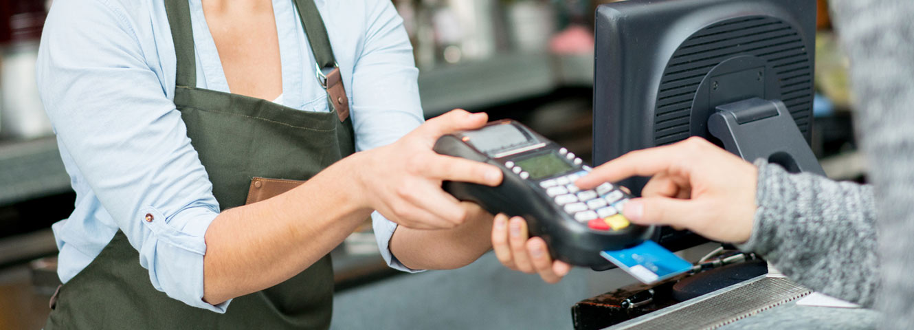 Paying with card chip reader.